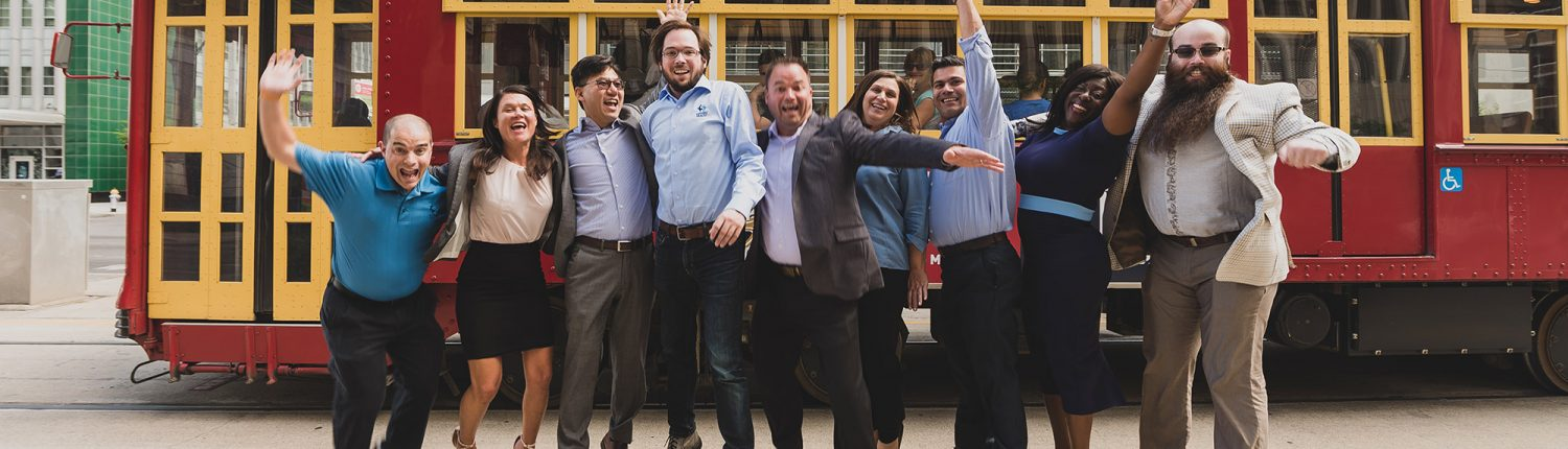 Sapphire Health team jumping in front of New Orleans trolley